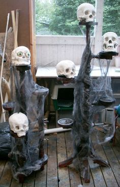 DIY Skull stands made from thrift store plant stands