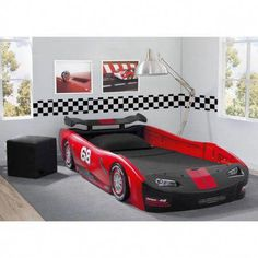Rev up your child's dreams with a comfortable sleep in the Delta Children Turbo Race Car Twin Bed. This sleek bed accommodates a standard twin mattress and resembles a classic race car with realistic details. High sides act as secure guardrails. Twin Car Bed, Kids Car Bed, Kids Toddler Bed, Twin Bunk Beds, Kid Beds, Childrens Bedroom Furniture, Toddler Furniture, Race Car Bedroom, Convertible Toddler Bed