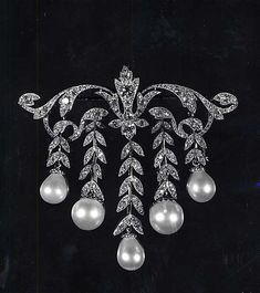 Diamond and pearl brooch.