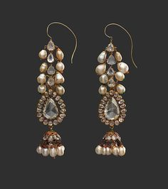 Diamond Earrings and Pearl Supports Object Name: Earrings Date: late 18th century Geography: India, Deccan, Hyderabad Culture: Islamic Medium: Diamond, pearls, gold, emeralds, and enamel