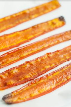 Everyone loves bacon, but the greasy side can leave you feeling sluggish and full. This savory carrot bacon is tasty, healthy bacon for clean eaters. Carrot Bacon Recipe, Bacon Recipes, Vegetable Recipes, Vegetarian Recipes, Cooking Recipes, Veggie Meals, Healthy Recipes, Bacon Chips, Carrot Chips