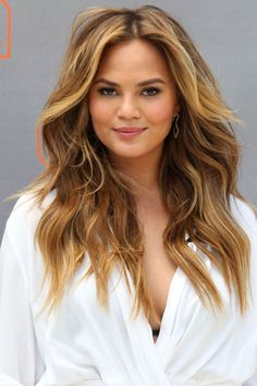 Nothing is more effortlessly sexy than model Chrissy Teigen's loose tumble of textured waves. Blast with a blow-dryer and a round brush for an easy daytime look. - ELLE.com