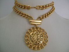 Stylish and Chic Vintage Signed MONET Circa 1970s Gold Tone Link Chain Necklace With Monogram Medallion Center/Pendant Absolutely Fabulous Heavy and Well Made Excellent Quality Piece It Weight 176.9 Grams. It is in Very GOOD vintage condition with only little signs of wear due to its age there are some tiny dark spots on a few link at the back., Overall this classic piece is clean shiny and ready to wear! Necklace measures approx: 28 long the center/pendant is 2-7/8 tall by lit...