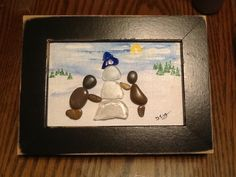 "Pebble art ""Building a snowman"""