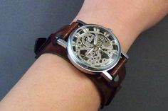 A unique, handmade, leather watchband. The vintage brown leather is cut and dyed by hand. The watchband is combined with a classic self-winding