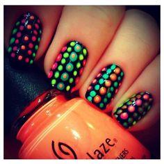 Layered polka dot nails.