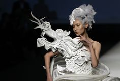 A model presents a creation by Chinese designer Xu Ming for a haute couture collection at China Fashion Week in Beijing China Fashion, Fashion Art, Fashion Design, Moda China, China Mode, Dragons, Asian Artwork, Art Asiatique, Beijing China