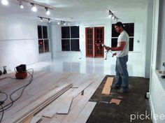 Using plywood (YES, PLYWOOD) for your wood floors.  Super cheap, kind-a easy and reviews say WAY durable!  wow.