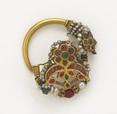 mughals: Nose ring, around 18th Century Mughal Dynasty. It is hard to believe how much wealth in gold, rubies, emerald, pearls, the list goes on the Indians had.