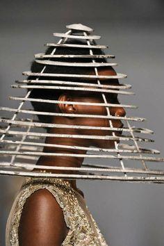 Newspaper Couture (2012). Brazilian designer Mary Design's headgear using a refined paper mache technique that preserves the fine print. via trendhunter