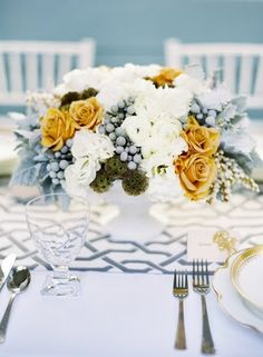 Light, modern and low gray and yellow centerpiece.  Like the pattern on the table runner, also!