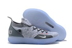 a086628fe01d This Nike KD 11 features a Cool Grey Flyknit upper paired with a darker  shade of Grey on the heel counter.