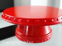 diy cake stand--burner cover and clay pot. I have really been wanting a cake stand, this looks perfect for a shabby sheek party with hints of red