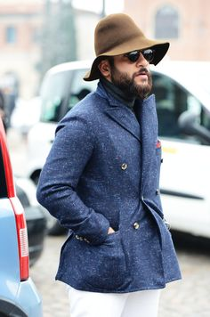 A navy pea coat and white chinos are a great outfit formula to have in your arsenal.  Shop this look for $91:  http://lookastic.com/men/looks/white-chinos-and-navy-pea-coat-and-red-pocket-square-and-navy-turtleneck/985  — White Chinos  — Navy Pea Coat  — Red Pocket Square  — Navy Turtleneck