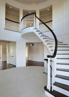The curvature of this staircase in Jennifer Lopez's chic Hamptons home