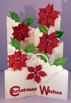 Christmas Cascade Card by Shirley Young A flat folding cascade fold card featuring poinsettias and holly. A back panel is included for your…