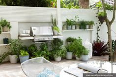 Built-in, natural-gas powered, cantilevered grill.  Maybe herbs in containers below and around.