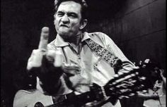 """Hands down the best Johnny Cash poster around! This iconic Johnny Cash poster is from a photo taken at San Quentin in A must have for fans of the Man in Black, this picture was in response to the inquiry """"John, let's do a shot for the warden"""". Rock And Roll, Johnny Cash Poster, Johnny Cash Middle Finger, Historia Do Rock, Jim Marshall, Music Rock, Public Enemies, Cinema Tv, Men In Black"""