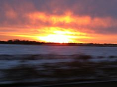 Sunset over snowy fields in Illinois along  I-80, 2013.