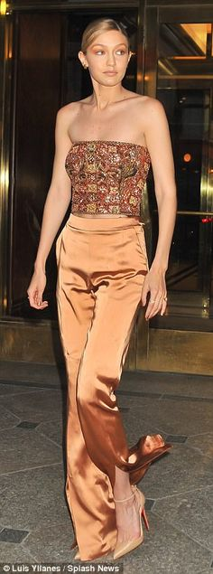 Bright young things: Gigi Hadid and Lily Collins flew the youth fashion flag in NYC on Monday night in contrasting skin-baring ensembles