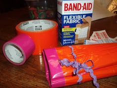 Duct Tape Mini First Aid Kit Roll  Pocket Supplies: Band-Aids, Antibiotic Cream, Cleansing Wipes  Good for a Girl Scout Camp Activity