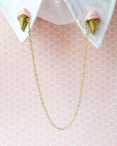 Handmade pink and gold polymer clay ice cream cone collar pins with attached gold chain.