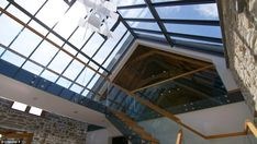 The modern glass roof links the ancient barn with the new to create an open, bright home...