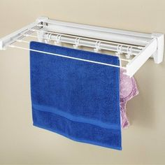 """Retractable Drying Rack by Whitmor, Inc. $37.48. Dimensions: 13.25"""" L x 25.25"""" W x 4.75"""" H. Folds away when not in use. Conveniently attaches to the wall. Includes add accessory hooks to add to the drying space. This retractable drying rack is a great option for drying your delicates. 7243-3625 Features: -Drying rack.-Folds away when not in use. Includes: -Includes added accessory hooks to add to drying space.. Save 20% Off!"""
