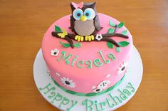 Micaela's Owl Cake - For a tween who loves owls. Fondant covered with owl made with RKT then covered in modeling chocolate and fondant.