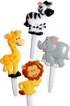 """Zoo Animal Baby Shower Picks  #89A-28  $2.25 per pkg of 12  These assorted animal-shaped snack picks are a light-hearted choice for your next baby shower. The guests will be charmed when you add this collection of colorful critters to snacks or cupcakes, hors d'oeuvres, or veggies. Team them with our Nursery Parade Partyware and a fun time will be had by all. Animals in the assortment include elephants, lions, zebras, and giraffes. Picks vary in height from the 3"""" tall giraffe to the 2 1/2""""…"""