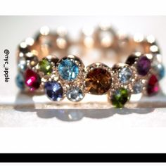 Multicolor Gemstone Ring Beautiful ring with rainbow gemstones/crystals. Shades of peridot, citrine, amethyst, garnet, blue topaz, emerald and diamond. Please ask if you have any questions. Jewelry Rings