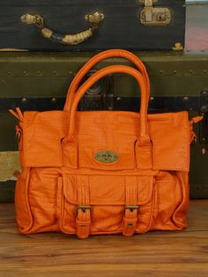 I love an orange purseSo I am in search of an orange purse for my capsule wardrobe since it adds color but matches most other colors. Way more interesting than a neutral purse Fall Bags, Summer Bags, Orange Purse, Balenciaga City Bag, Purses And Handbags, Color Pop, Autumn Fashion, Shoulder Bag, My Style