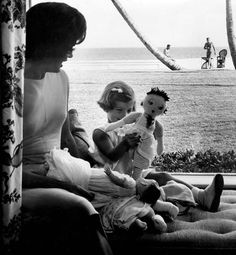 Jackie Kennedy with Caroline and John F. Kennedy in the background -- photo by Richard Avedon
