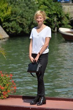 Italian actress Alba Rohrwacher poses with her Fendi By The Way bag and a pair of Fendi black booties from the Prefall 2014-15 Collection at the 71st Venice Film Festival