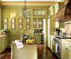 antique yellow kitchen, copper hood. Love the lights!