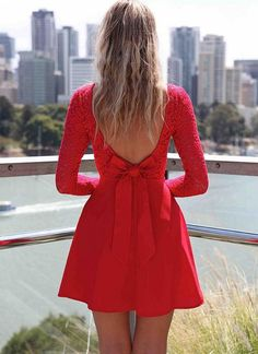 Fun skater style dress with lace upper Long sleeves for the winter Low V back with bow detail Invisable side zipper opening