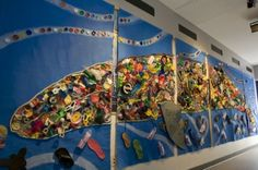Carlsbad 1st graders make a whale out of beach trash! Way to clean up the beach and make pretty art at the same time-that's pretty cool;)
