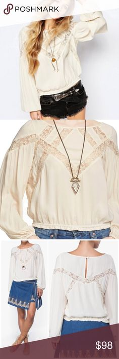 "Free People Geometry Lesson Lace Top Rock this 70s-inspired Geometry Lessons Top from Free People. This piece screams boho chic in so many ways, its boat neck and long sleeves are just the beginning of the perfect top. Not to mention its lace insets and elasticised hem keep it versatile and comfy piece! Pair this women's top with some distressed high-waisted jeans and some cute booties for an upgraded casual look. Measures pit to pit 21""/ length 23""  Cream polyester-blend Top simply slips on…"