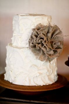 Small Wedding Cake with Burlap Flower. I like this for the Bridal party and close family. Big sheet cake for everyone else