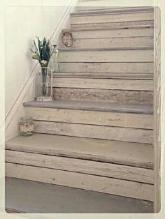 Staircase makeover using pallet effect wallpaper decoupage on the risers. Love it!