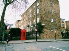 Typical London street,house, red telephone booth