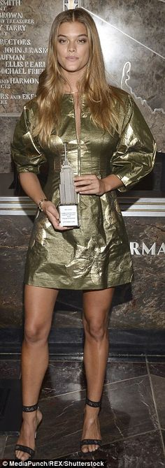 Glamorous in green: The 24-year-old model wowed in an olive zip-up dress that…