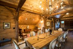 B&D built this timber frame loft to entertain. The exposed beams and wooden floor add warmth and character. Barn Siding, Exposed Beams, Wooden Flooring, Horse Barns, My Dream Home, Equestrian, Sheds, Timber Flooring, Hardwood Floors