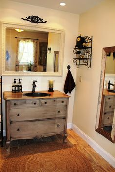 Bathroom Vanity from an old dresser, the color used is Navajo White by Behr. See website: onfernavenue.com