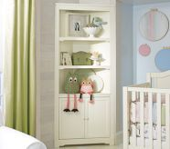 classic corner cabinet for a small nursery