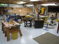 """[Click for full-size]  Dream shop. Peck moved into a new house with a large basement--perfect for a dedicated shop. Furniture """"commissions"""" rolled in before he could complete it so he ended up buying tools on an as-needed basis."""