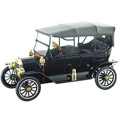"""Masterfully crafted in die cast metal and plastic with over 120 parts, this spot-on replica of the soft top """"Tin Lizzy"""" features padded upholstery, opening front and rear doors, rubber whitewall tires, gold trim, authentic interior, and a highly detailed engine under the louvered butterfly hood.  A real beauty!"""