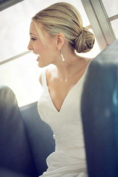 low bun hair style via Project Wedding