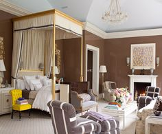 Grand bedroom with chocolate walls and a magnificent canopy bed!