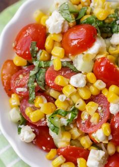 This Summer Corn Salad is a light, flavorful salad filled with corn, tomatoes, feta, basil and cucumber. It's perfect for BBQs and holidays and is so simple and quick that it's perfect for get togethers and BBQs. Corn Tomato Salad, Tomato Dishes, Tomato Basil, Corn Salad Recipes, Corn Salads, Vegetable Salads, Corn Salad Recipe Easy, Summer Corn Salad, Summer Salads